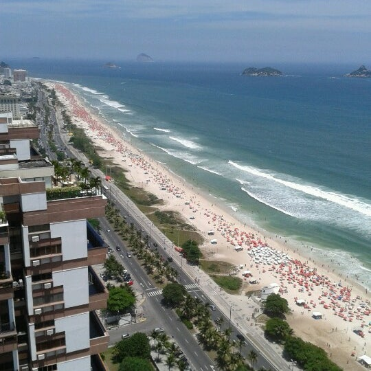 Photo taken at Praia da Barra da Tijuca by Marina K. on 2/3/2013