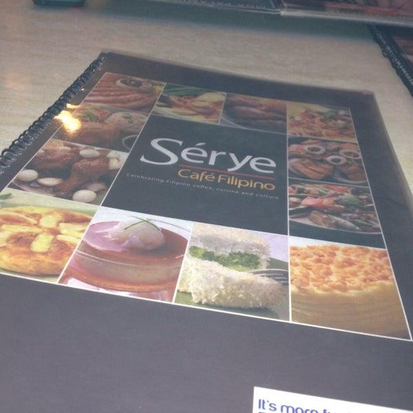 Photo taken at Sérye Café Filipino by Marianne V. on 7/11/2013