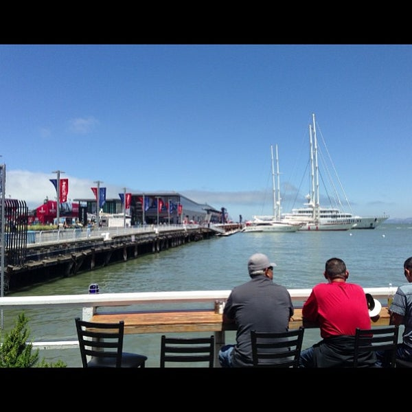 Photo taken at Pier 23 Cafe by Dio V. on 7/8/2013