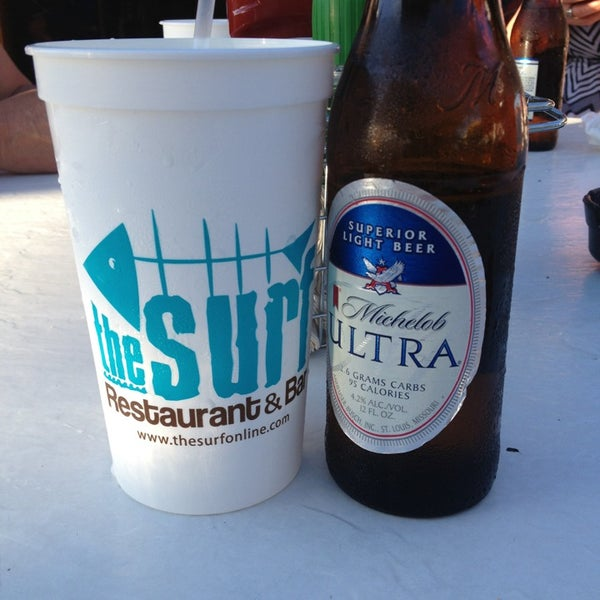 Photo taken at The Surf Restaurant & Bar by Sara K. on 4/13/2013