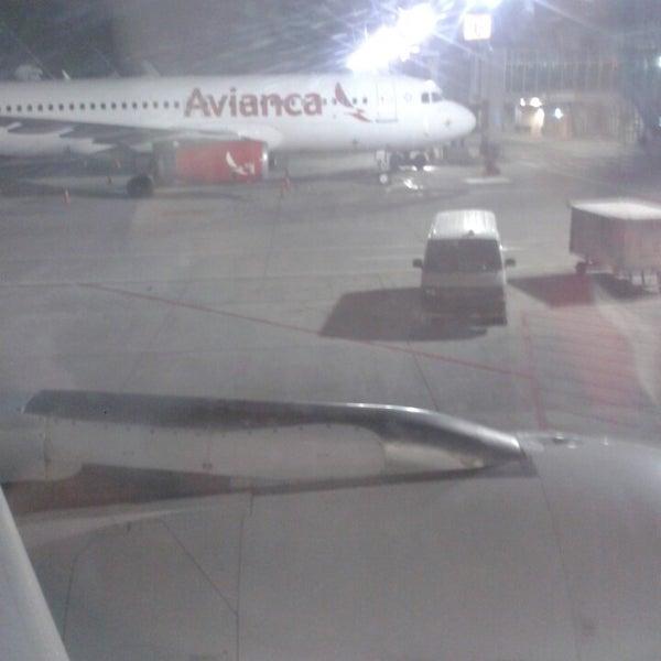Photo taken at Gate 5 Aeropuerto Internacional Juan Santamaria by Michael R. on 4/12/2014