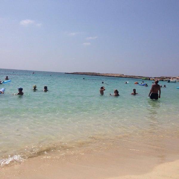Photo taken at Makronissos beach by Nadezhda U. on 8/6/2016
