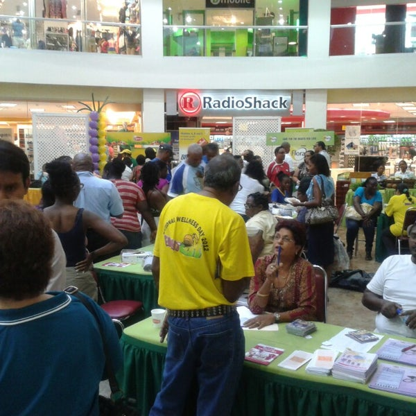 Photo taken at Trincity Mall by Alex R. on 4/26/2013
