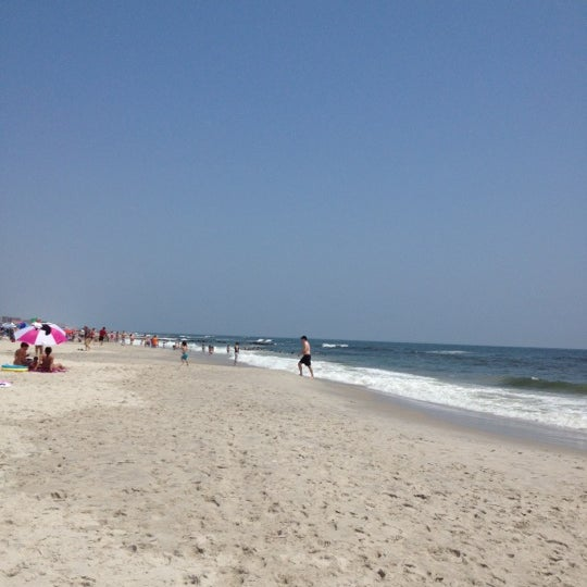 Photo taken at East Atlantic Beach by Chris C. on 5/28/2012
