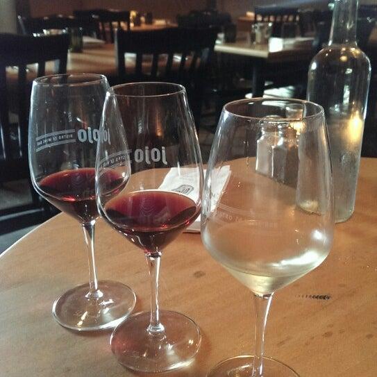 Photo taken at JoJo Bistro & Wine Bar by Camille C. on 7/23/2014