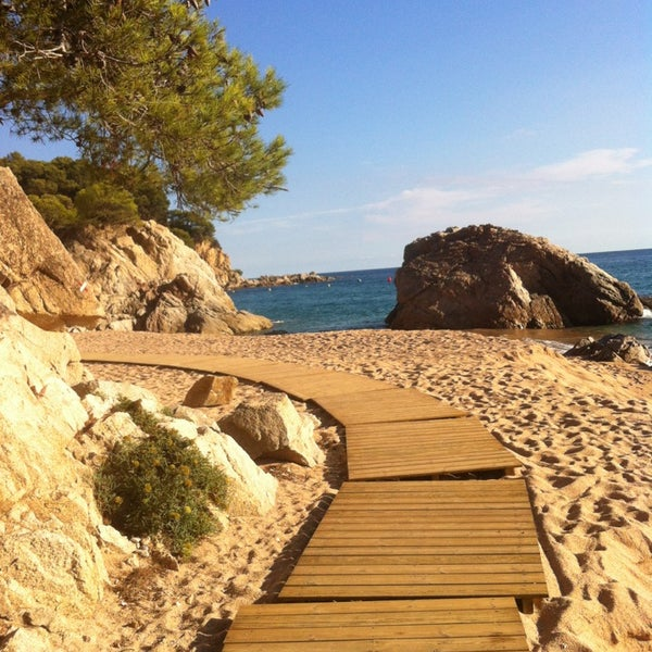 Photo taken at Cala Canyelles by Olena on 10/7/2013