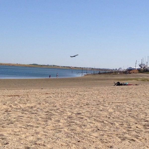 Photo taken at Constitution Beach by Liz D. on 5/11/2014