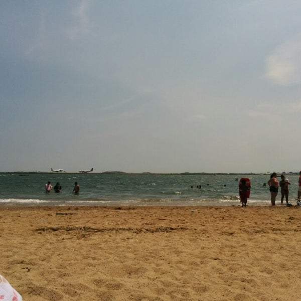 Photo taken at Constitution Beach by Brandon H. on 7/13/2014