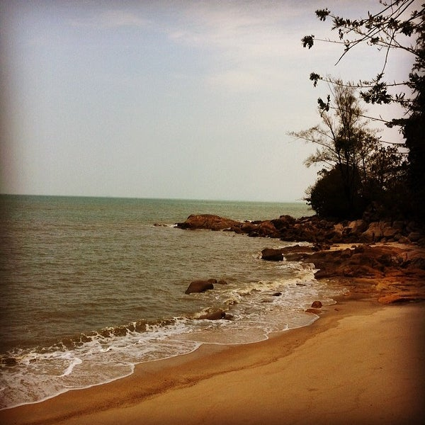 Photo taken at Teluk Bahang Beach by Josephine T. on 2/20/2014