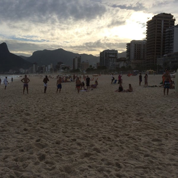 Photo taken at Praia de Ipanema by W-t P. on 7/8/2014