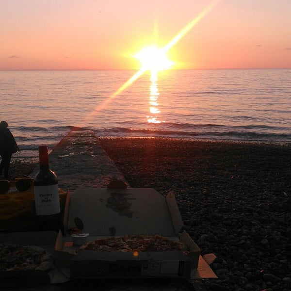Photo taken at Aberystwyth Beach by Elif E. on 9/8/2015