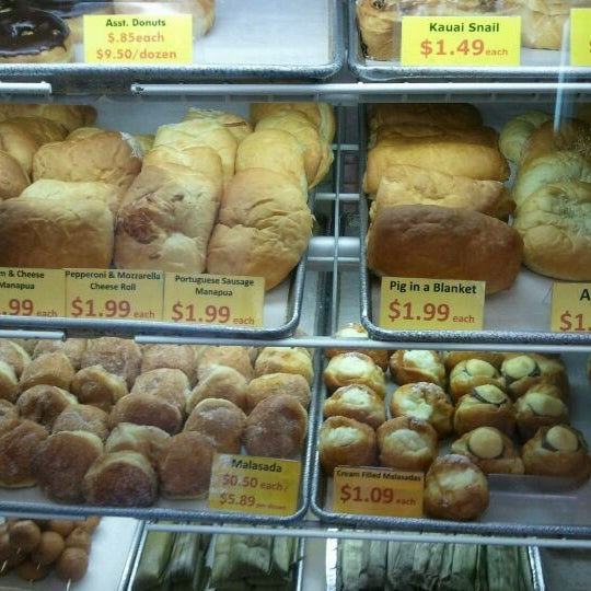 Photo taken at Kauai Bakery by ernie e. on 3/26/2012