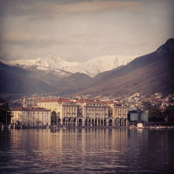 Photo taken at Lago di Lugano by Adam M. on 3/16/2014