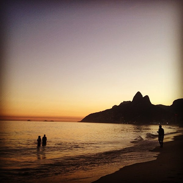 Photo taken at Praia de Ipanema by Tayssa S. on 7/7/2013