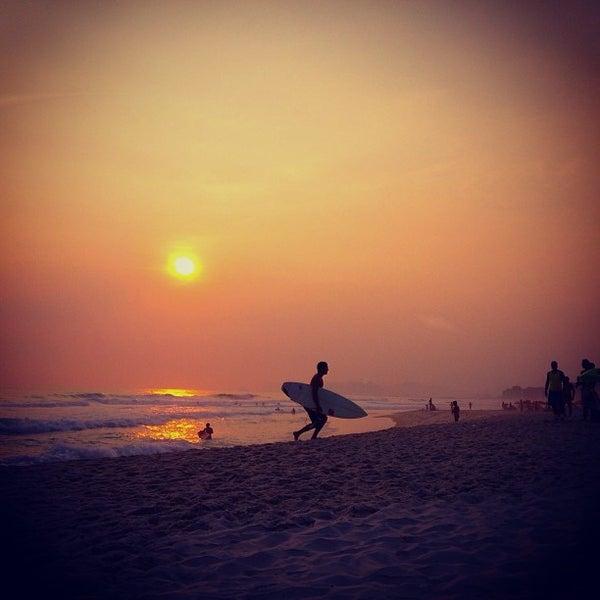 Photo taken at Praia da Barra da Tijuca by Lu M. on 1/4/2013