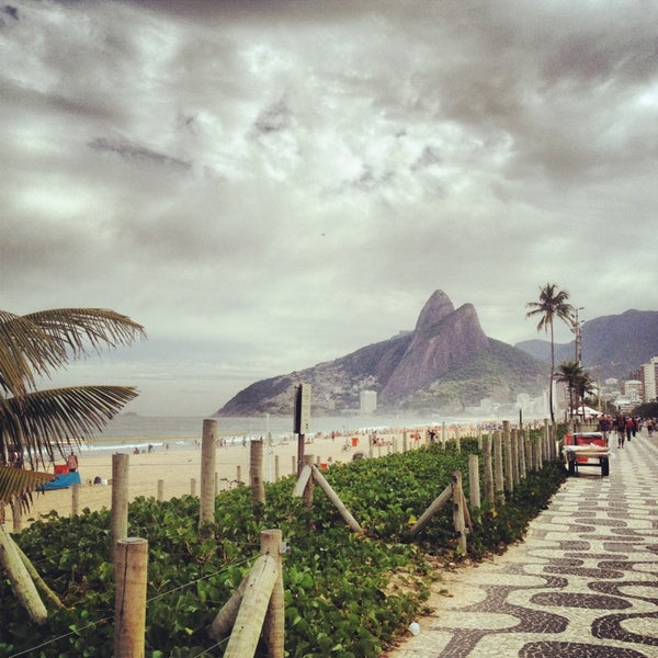 Photo taken at Praia de Ipanema by Willa S. on 5/30/2013