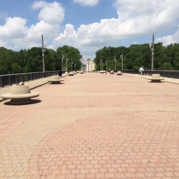 Photo taken at John T. Myers Pedestrian Bridge by Nick P. on 6/16/2014