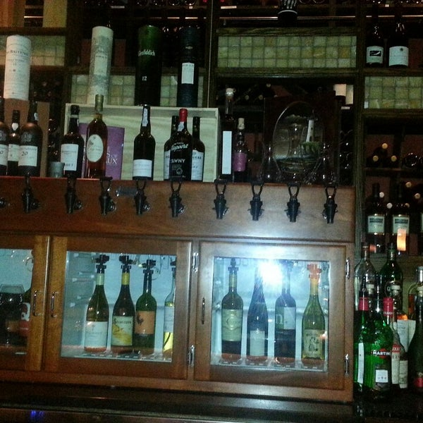 Photo taken at D.O.C. Wine Bar by Val D. on 10/31/2013