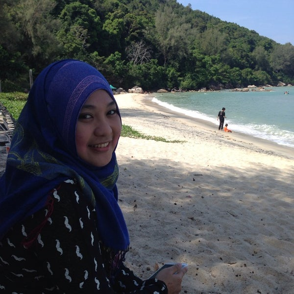 Photo taken at Teluk Bahang Beach by Mohamad A. on 1/1/2014