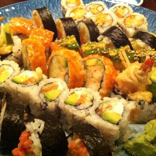 Photo taken at Sushi Lounge by Megan D. on 4/16/2012