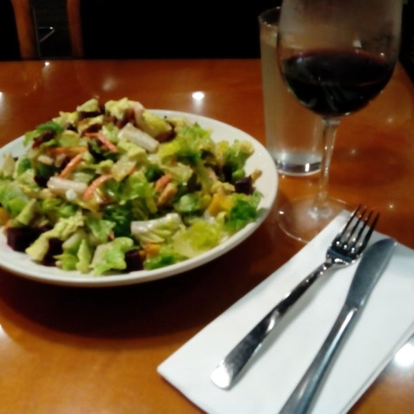 Photo taken at California Pizza Kitchen by Jerome R. on 12/15/2013