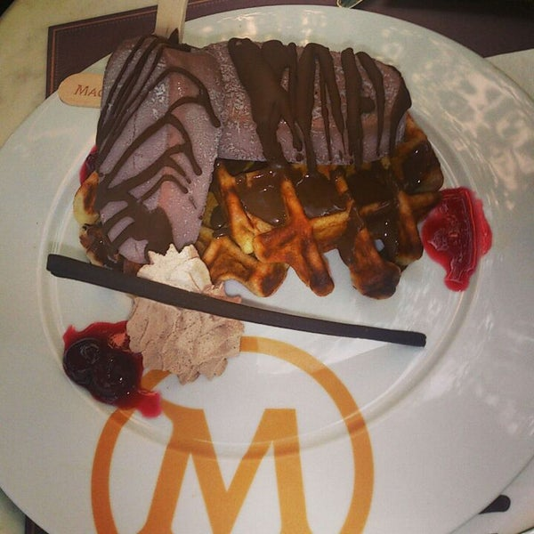 Photo taken at The New Magnum Café by Jemmy T. on 6/22/2013