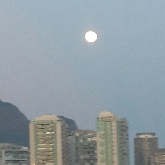 Photo taken at Praia da Barra da Tijuca by Alexandre C. on 3/15/2014
