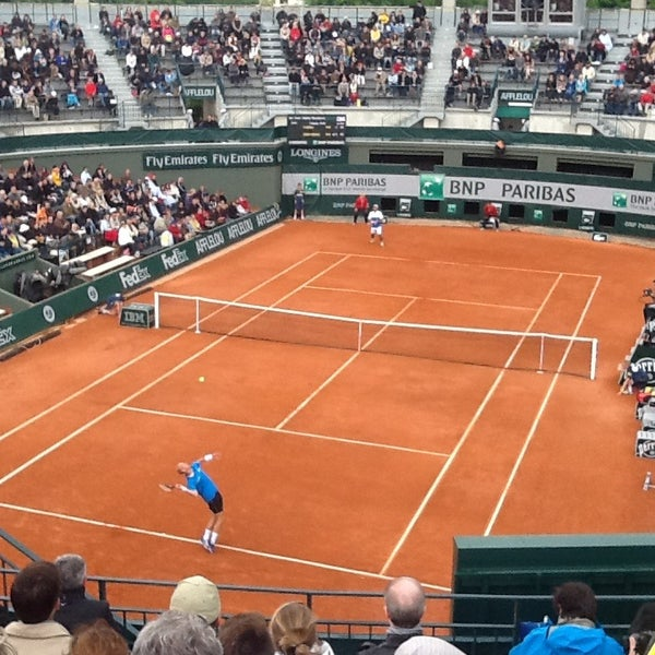 Photo taken at Stade Roland Garros by Julian H. on 5/28/2013
