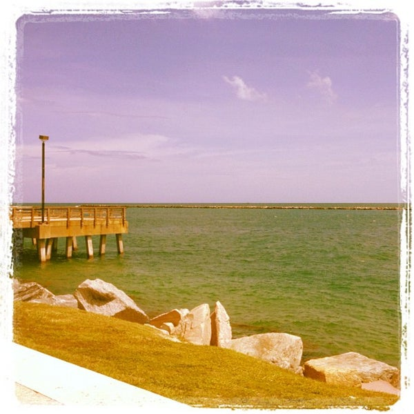 Photo taken at South Pointe Pier by Alessandro S. on 6/27/2012