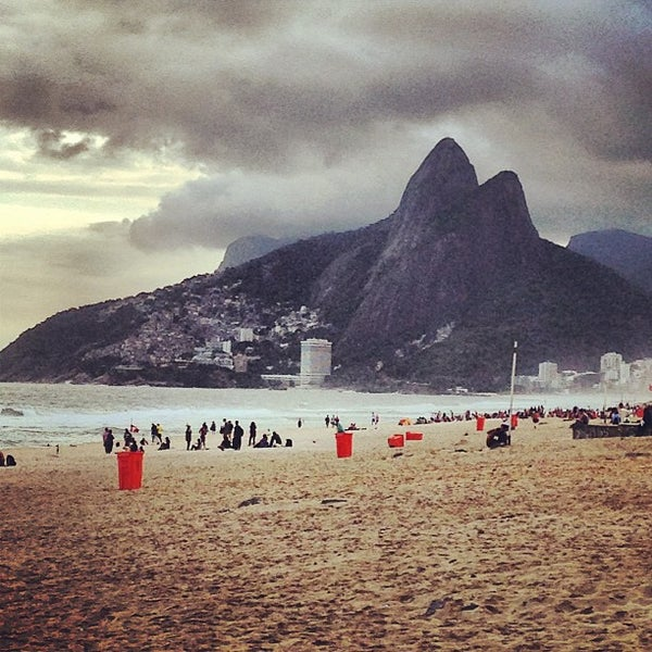 Photo taken at Praia de Ipanema by Chris H. on 5/19/2013