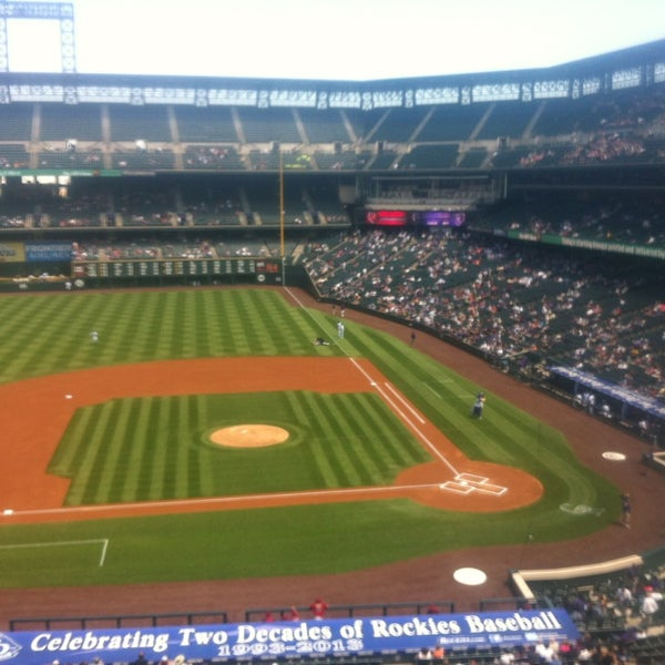 Photo taken at Coors Field by Sara Z. on 5/22/2013