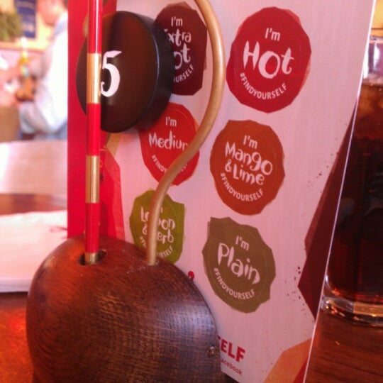 Photo taken at Nando's by Alex T. on 11/10/2012