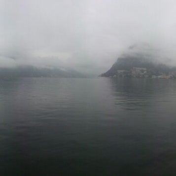 Photo taken at Lago di Lugano by Nuri Y. on 10/8/2014