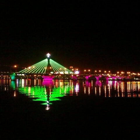 Photo taken at Cầu Sông Hàn (Han River Bridge) by Nguyen D. on 1/22/2013