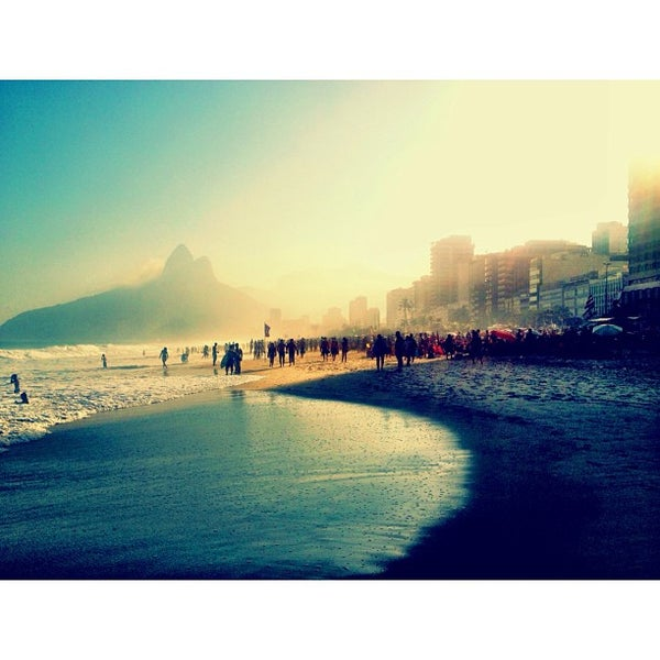 Photo taken at Praia de Ipanema by Hugo L. on 7/20/2013