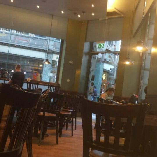 Photo taken at Caffè Nero by Guilherme C. on 7/19/2013