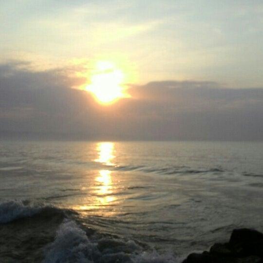 Photo taken at Pantai Barat Pangandaran by Yuliana K. on 5/16/2015