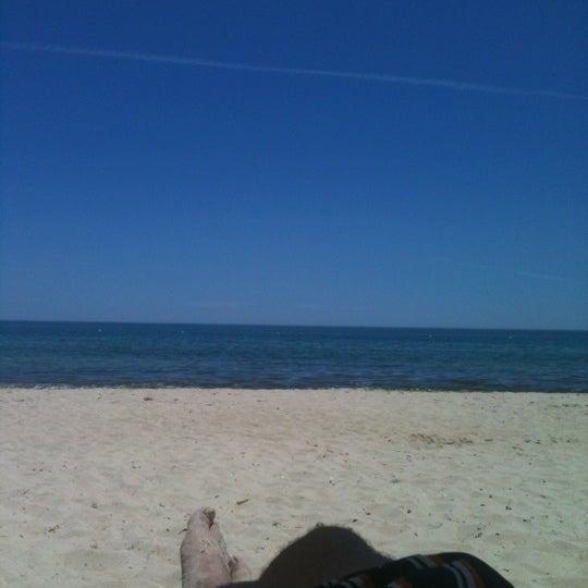 Photo taken at Praia do Barril by Rafael P. on 7/2/2012