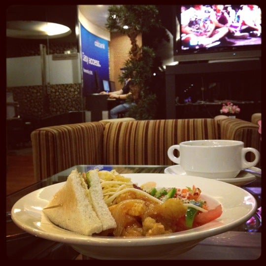 Photo taken at Citibank Lounge by Caryn T. on 2/11/2012