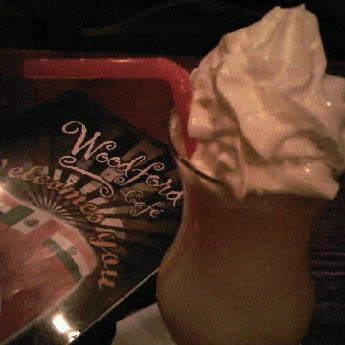 Photo taken at Woodford Café by Modern C. on 10/8/2011