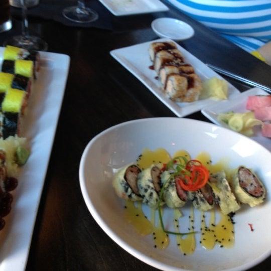 Photo taken at Blue Sushi Sake Grill by Lana E. on 6/21/2012