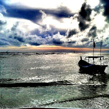 Photo taken at Teluk Bahang Beach by Farizol Z. on 7/11/2012