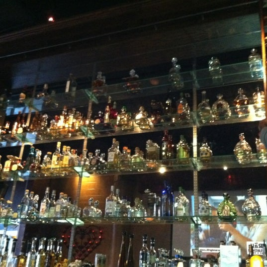 Photo taken at Barrio Tequila Bar by Kayla A. on 4/18/2012