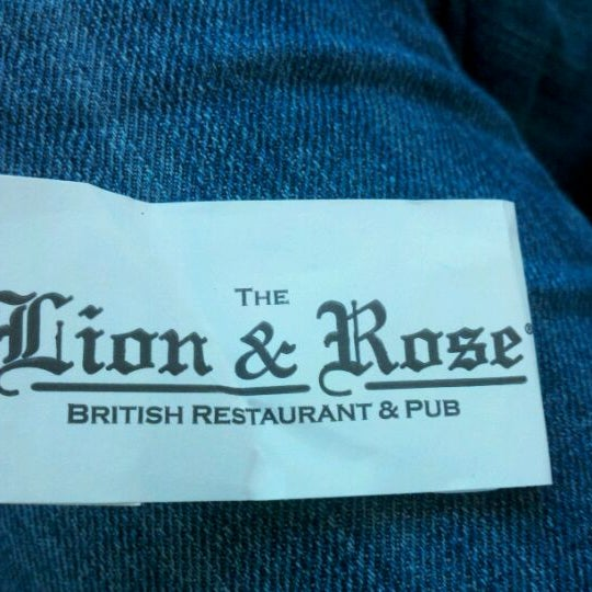Photo taken at The Lion & Rose British Restaurant & Pub by Andrea B. on 11/17/2011