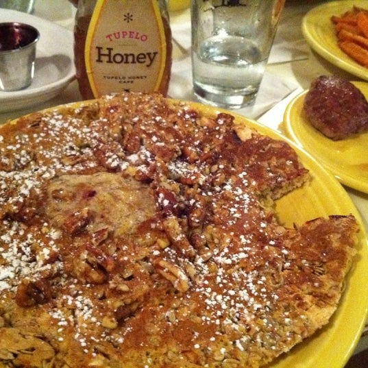 Photo taken at Tupelo Honey Cafe by Fiona S. on 1/11/2012