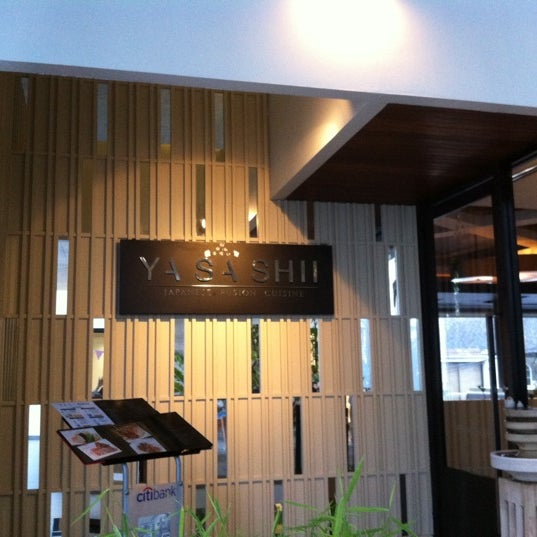 Photo taken at YASASHII Japanese Fusion Cuisine by Emmie A. on 5/3/2012