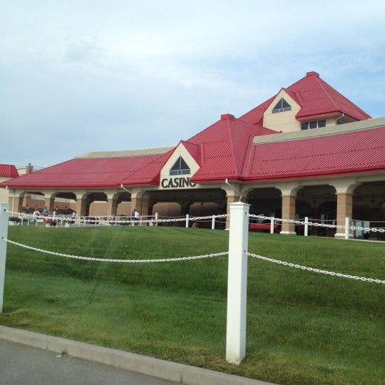 Photo taken at Prairie Meadows by Aaron H. on 8/11/2012