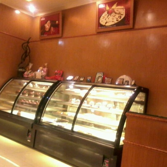 Photo taken at Mawar Bakery and Cake Shop by umminya a. on 3/12/2012