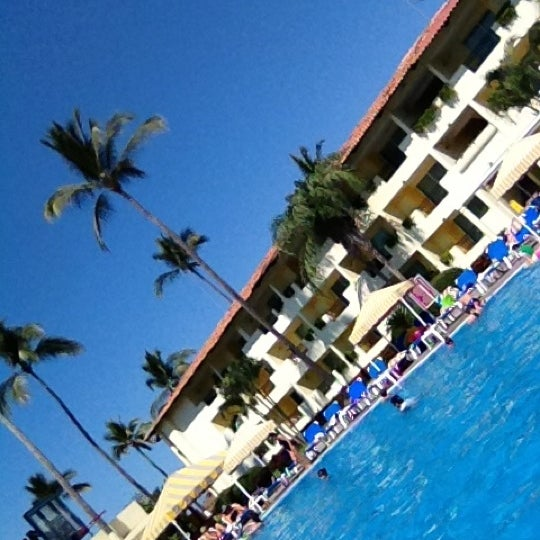 Photo taken at Crown Paradise Club All Inclusive Resort by Gustavo A. on 3/12/2012