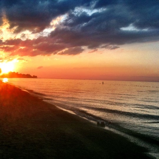Photo taken at Durand Eastman Beach by Tricia R. on 7/7/2011